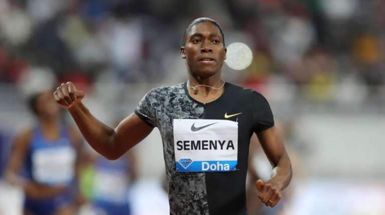 South Africa's Caster Semenya crosses the line to