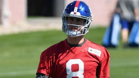 Giants quarterback Daniel Jones looks on from the
