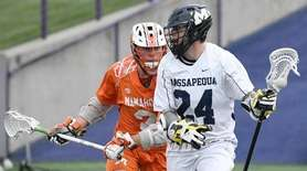 Mamaroneck's Shane Smith (21) defends against Massapequa's Eamon