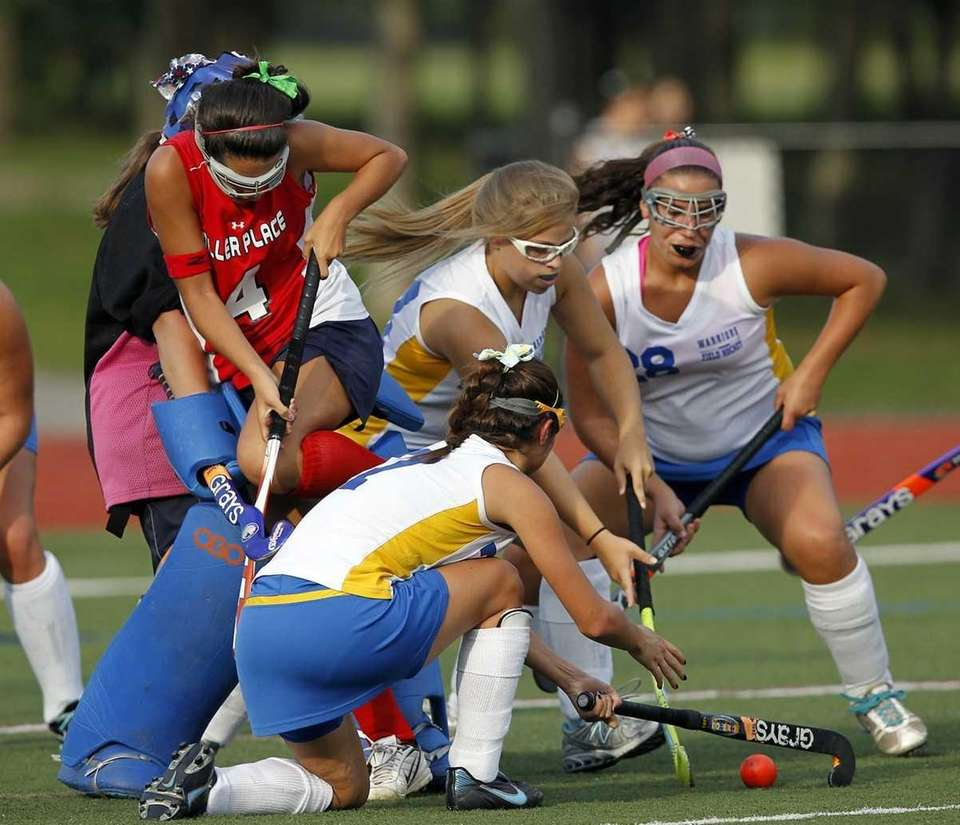 Miller Place's Jamie Emma (4) bails from the