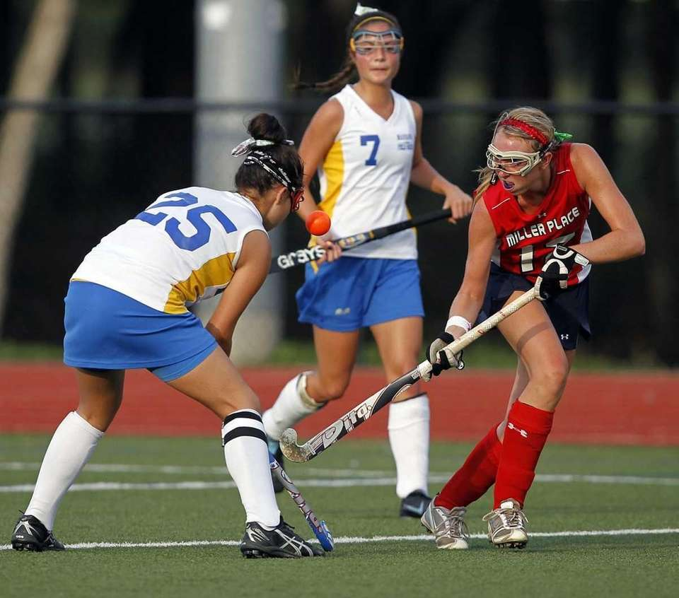 Miller Place's Maggie Gersbeck (12) taps the ball