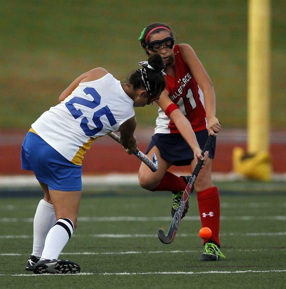 Miller Place's Megan Gonzalez (11) blocks a passing
