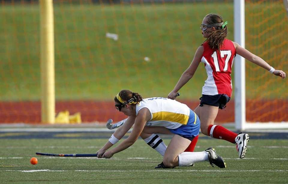 Comsewogue's Mary Kate McCormick (1) takes a low