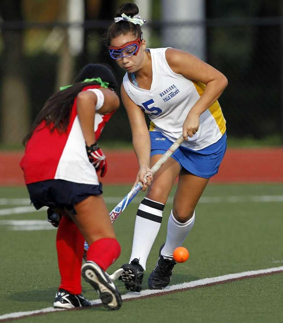 Comsewogue's Alex Hagney (25) takes the ball from