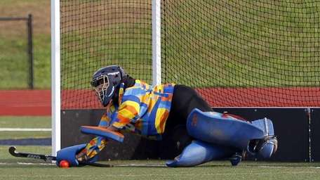 Miller Place goalie Chelsea Blaney (80) smothers a