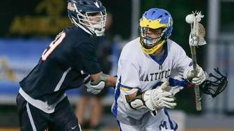 Mattituck's Max Kruszeski (6) gets his stick checked