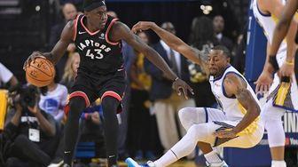 Toronto Raptors forward Pascal Siakam controls the ball