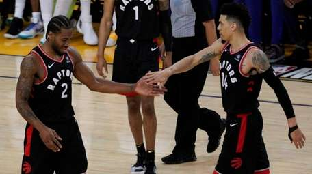 Toronto Raptors forward Kawhi Leonard celebrates with Danny
