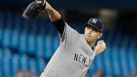 New York Yankees starting pitcher James Paxton throws