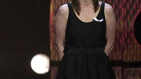 Actress Leisha Hailey appears on stage to accept