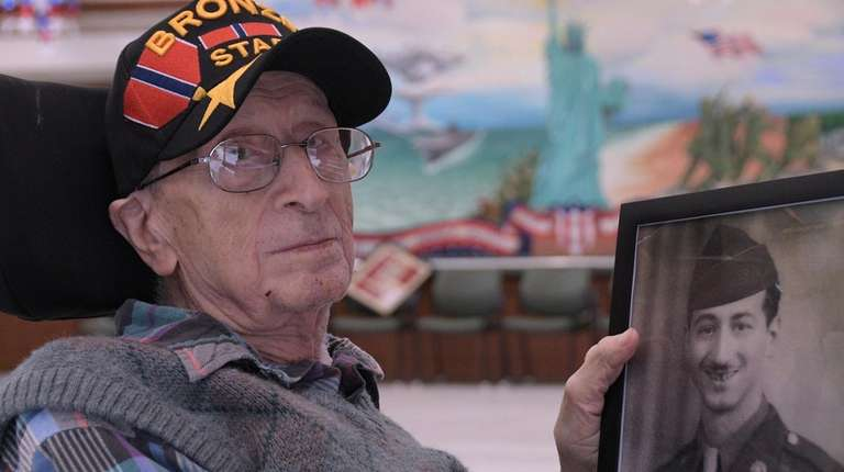 Frank DePergola, 96, seen with a photo of