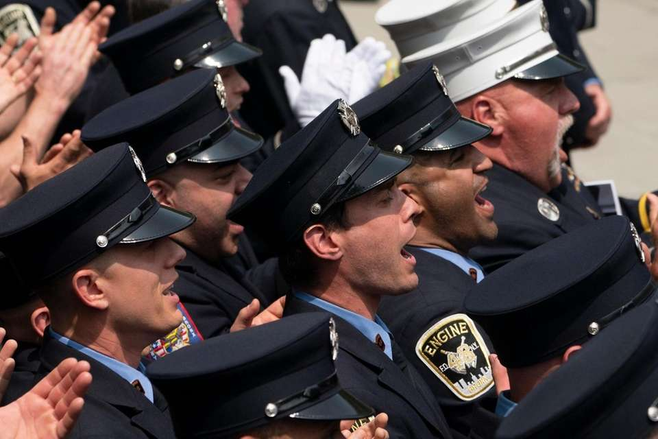 Members of the FDNY cheers as Lieutenant Patrick