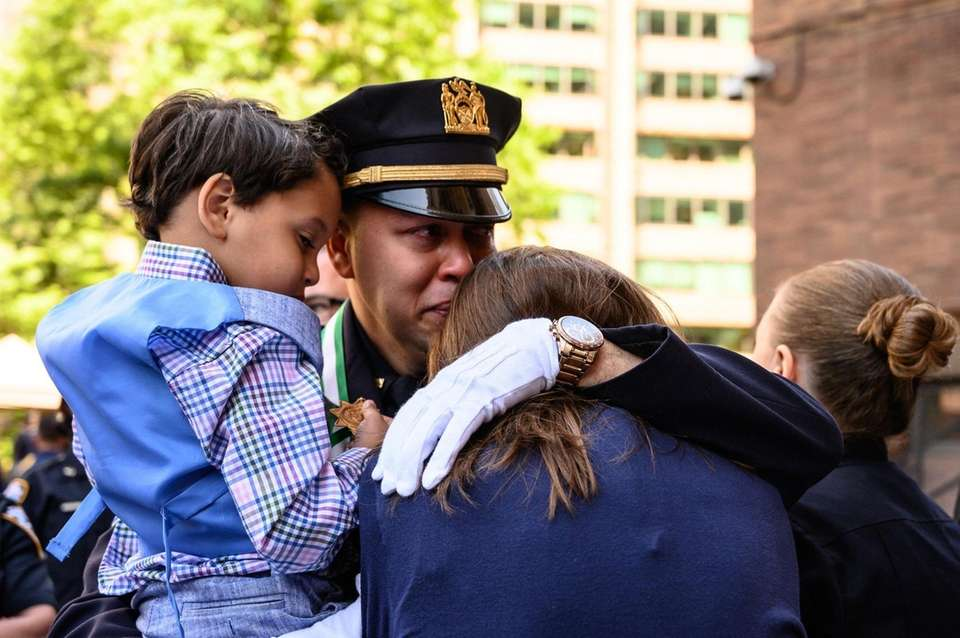 Sgt. Arvid Flores comforts Lisa Tuozzolo after he