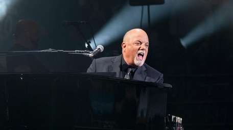 Billy Joel performs at a concert that also
