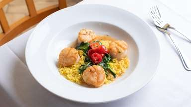 Seared scallop meuniere is served over orzo at