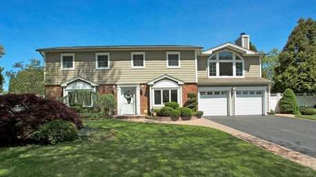 This East Northport Colonial is listed for $725,000.