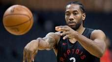 Toronto Raptors' Kawhi Leonard passes during practice for