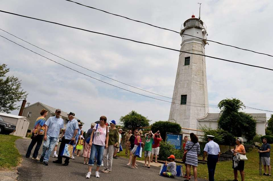 The crowd views the Eatons Neck Lighthouse as