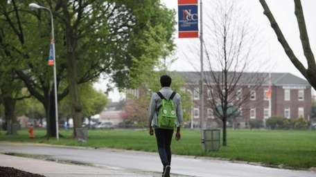 Students walk through the campus of Nassau Community
