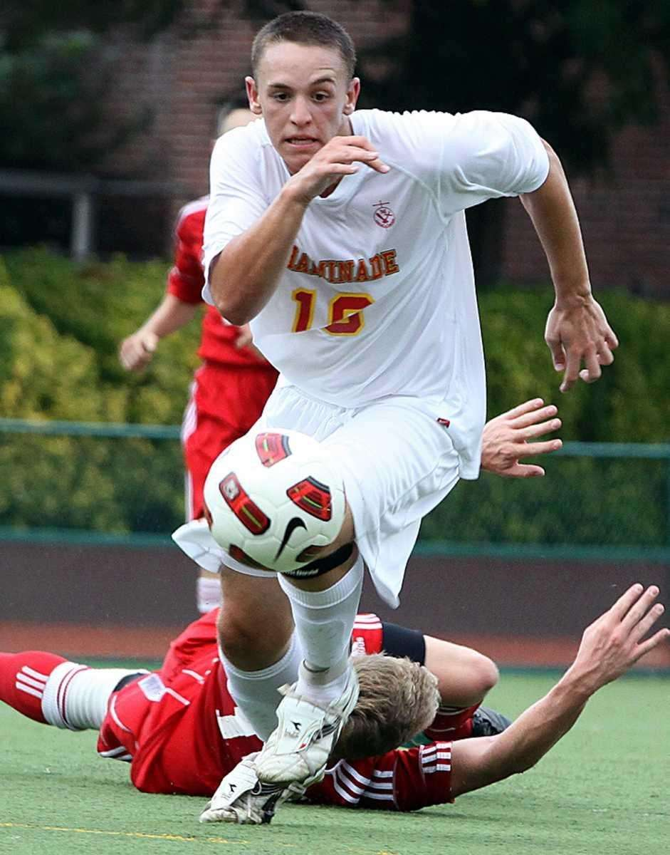 Chaminade's David Chiariello gets past defender during the