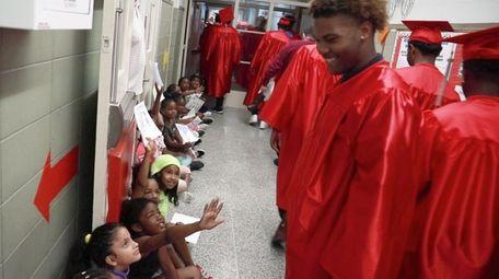 Amityville Memorial High School seniors were cheered as