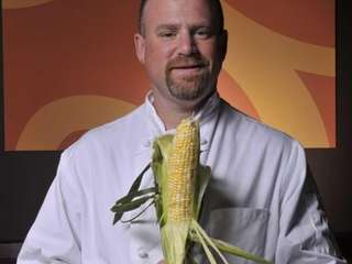Chef Mitch SuDock poses for a photograph in