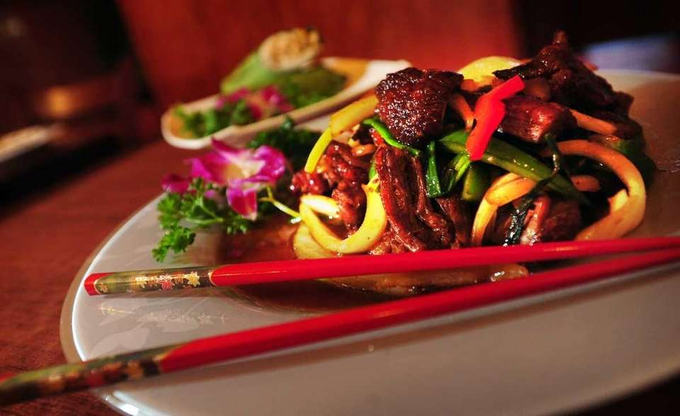 A dish of spicy basil duck is served