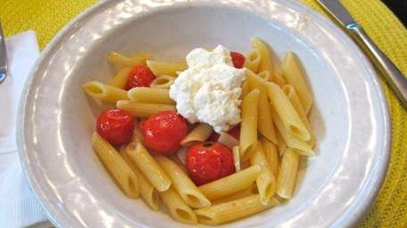 �A simple dish of pasta with roasted cherry