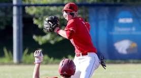 Center Moriches' Robert Capozzi (17) is forced at