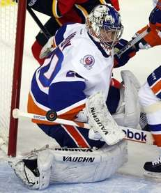 New York Islanders goalie Evgeni Nabokov deflects the