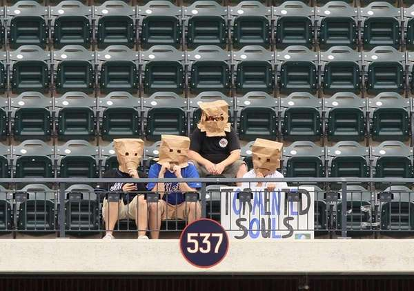 Fans of the New York Mets sit alone