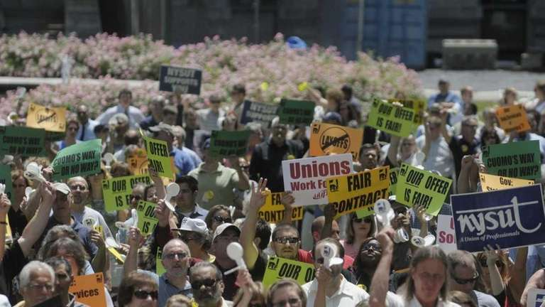 Unionized state workers fill the lawn outside the