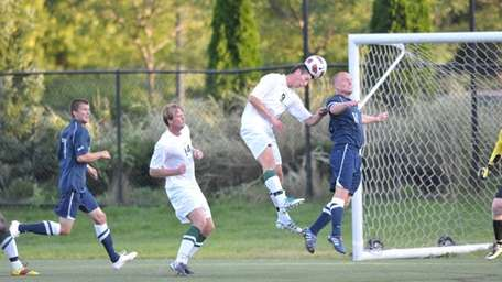 Eivind Austboe goes up for a header for