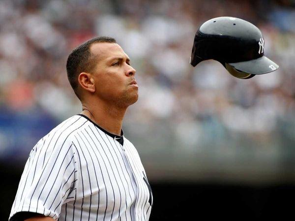 New York Yankees' Alex Rodriguez flips his helmet