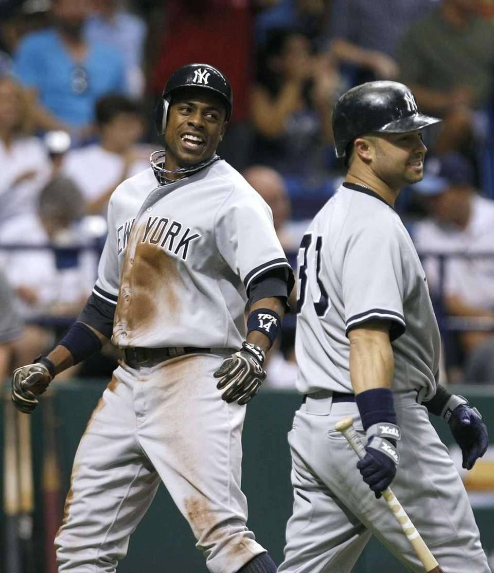 New York Yankees' Curtis Granderson, left, laughs with