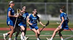 Mattituck/Southold's Francesca Vasile-Cozzo, right, celebrates with teammates Riley