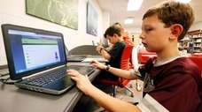 Third-grade student Miles Stidham uses an East Webster