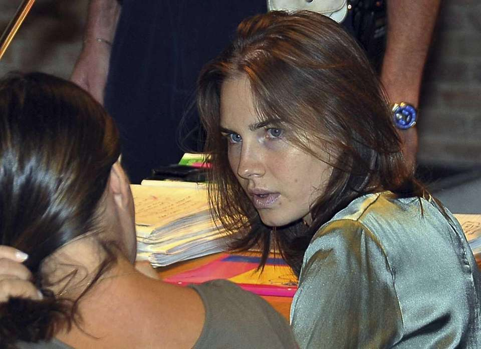 Amanda Knox, right, talks with her lawyer Maria