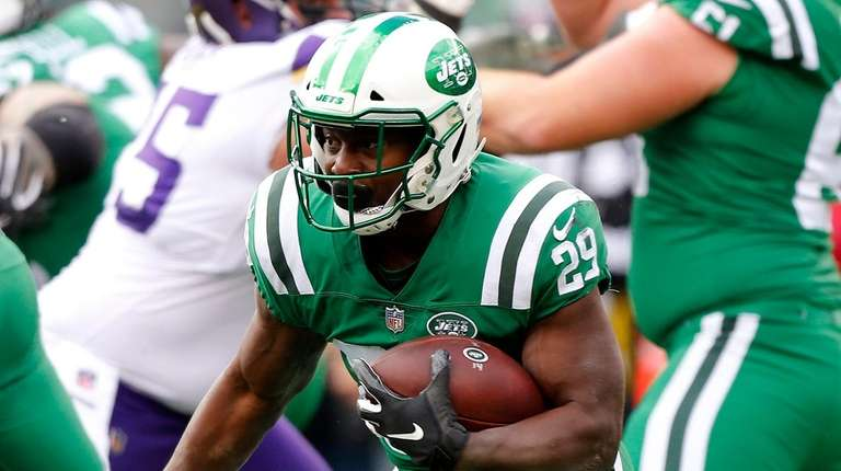 Jets' Bilal Powell runs the ball in the
