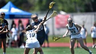 Northport's Kaylie Mackiewicz takes a shot over Pittsford's