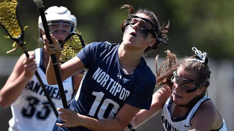 Northport's Olivia Carner, left, is defended by Pittsford's