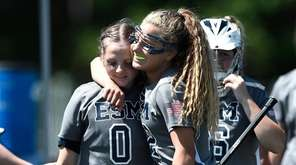 Eastport-South Manor's Ellie Masera, right, hugs goalie Katie