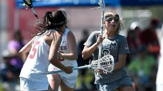 Eastport-South Manor's Kasey Choma, right, is defended by