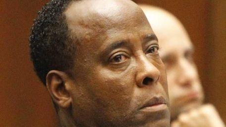 Conrad Murray listens to testimony from witness Faheem