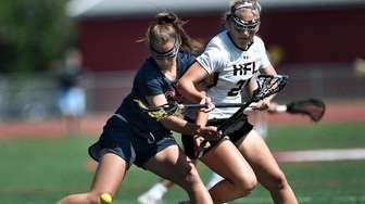 Cold Spring Harbor's Grace Tauckus, left, and HF-L's