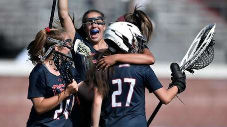 Cold Spring Harbor players celebrate their win against