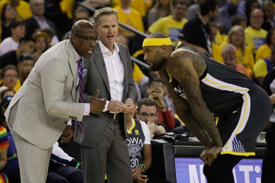 Golden State Warriors assistant Mike Brown left, and