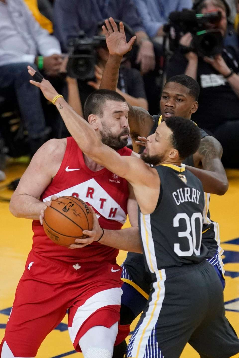 Toronto Raptors center Marc Gasol, left, is defended