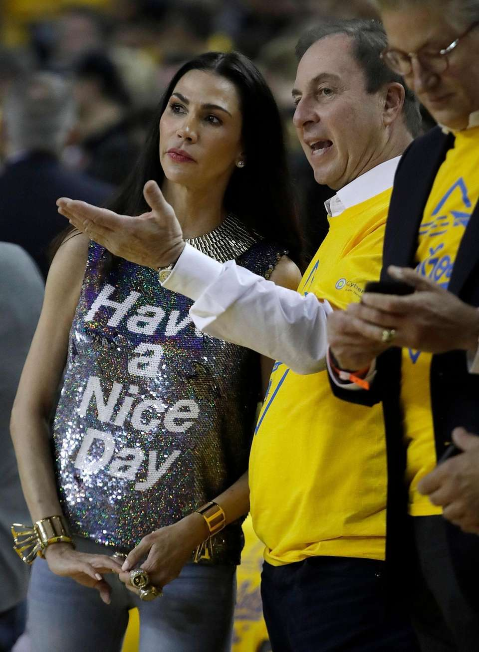 Golden State Warriors owner Joe Lacob, right, gestures