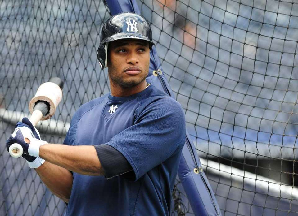 Robinson Cano takes batting practice during a workout